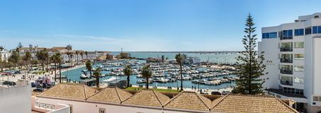 Faro - Portugal, April 1, 2018: Panoramic view of the marina of the city of Faro near the hotel Eva. Royalty Free Stock Photography