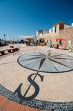 View of a stone pavement mosaic of a wind rose pattern. Faro, Portugal - July 16, 2018: View of a stone pavement mosaic of a wind rose pattern Royalty Free Stock Photo