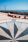 View of a stone pavement mosaic of a wind rose pattern. Faro, Portugal - July 16, 2018: View of a stone pavement mosaic of a wind rose pattern Stock Photo