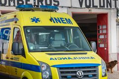 Ambulance parked in front of a volunteer fire station in faro. Faro, Portugal - May 01, 2018: ambulance parked in front of a volunteer fire station on a spring stock photo