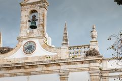 Architecture details of the Arco de Vila of Faro. Faro, Portugal - May 1, 2018: Architecture details of the Arco de Vila arch of the city, one of the gateways of Stock Images