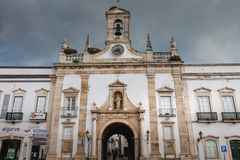 Architecture details of the Arco de Vila of Faro. Faro, Portugal - May 1, 2018: Architecture details of the Arco de Vila arch of the city, one of the gateways of Stock Photos