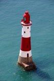 Faro principal con playas Imágenes de archivo libres de regalías