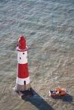 Faro principal con playas, Reino Unido Imágenes de archivo libres de regalías