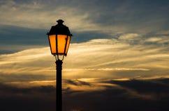 Faro, puesta del sol Imagen de archivo libre de regalías