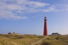 Faro rosso in dune a Schiermonnikoog Fotografia Stock