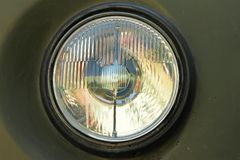 Faro rotondo della vecchia automobile Fotografia Stock