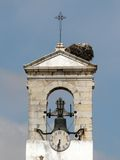 Faro's belltower and nest. Belltower of Faro with a stork nest, Algarve, Soouthern portugal stock image