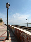 Faro's streetlamp, railway and ocean. The promenade around the walls of the old Town, Faro, Algarve stock photography
