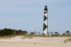Faro sopra le dune Fotografia Stock Libera da Diritti