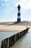 Faro su una spiaggia in Olanda Fotografie Stock