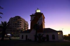 Faro verde del punto, puesta del sol (i) Fotografía de archivo