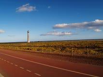 Faro vicino alla strada principale Fotografie Stock