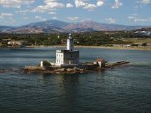 Faro viejo en el mar Imagen de archivo libre de regalías