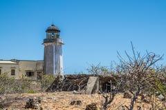 Faro viejo en la costa Foto de archivo libre de regalías