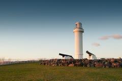 Faro y cañones en wollongong Imagen de archivo libre de regalías
