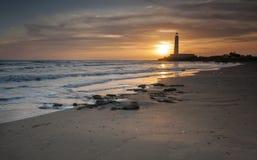 Faro y puesta del sol fotos de archivo
