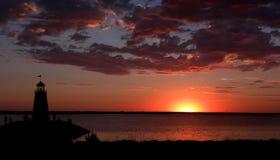 Faro y puesta del sol del lago Imagen de archivo