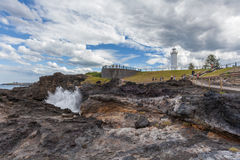 Faro y sopladura, Australia de Kiama Fotos de archivo libres de regalías