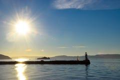 Faro y un barco Imagen de archivo libre de regalías