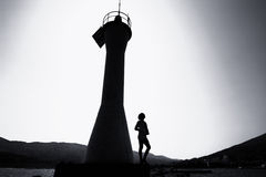 Faro y una mujer Imagen de archivo