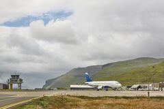 Faroe islands airport runway and control tower with airplane