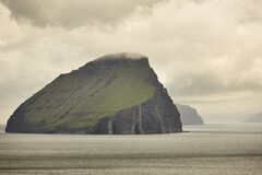 Faroe islands cloudy landscape and atlantic ocean. Vagar
