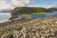 Faroe islands dramatic coastline in Vagar area. Hiking in Faroe