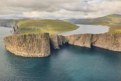 Faroe islands dramatic coastline in Vagar. Leitisvatn lake