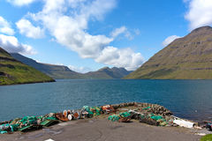 Faroe Islands, fishing nets in fiord landscape Royalty Free Stock Photo