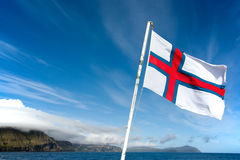 Faroe Islands flag waving in a sunny day Royalty Free Stock Images