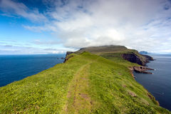 Faroe Islands, a green path in the ocean Stock Photos