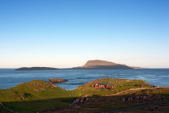 Faroe Islands landscape at sunset. Unspoilt landscape of Faroe Islands at sunset : Streymoy island coast, Atlantic Ocean and Nolsoy island in background . Low Royalty Free Stock Photos