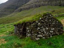 Múli Village. Old stone house with grass roof
