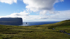 Faroe Islands, Risin og Kellingin. View of the Risin og Kellingin (giant and witch) rocks on Eysturoy Island on the road to Gjogv in the Faroe stock photography