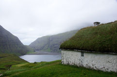 Faroe Islands, Saksun bay and grass house Stock Photo