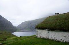 Faroe Islands, Saksun bay and grass house Stock Photo