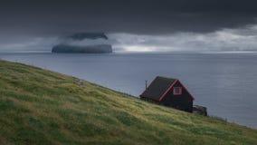 Faroese cottage at the coast of Vagar, Faroe Islands