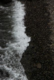 Faroese Harbour. Dark and stormy beach - Mykines - Faroe Islands Stock Photography