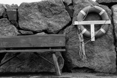 Faroese Harbour. Pier bench and lifebuoy - Leirvik - Faroe Islands Royalty Free Stock Image