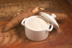 Farofa. Cassava Flour. Over a wooden table Stock Photo