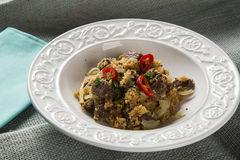 Farofa with dried meat and pepper.  Royalty Free Stock Photo