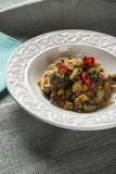 Farofa with dried meat and pepper.  Stock Photo