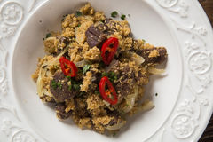 Farofa with dried meat and pepper.  Royalty Free Stock Images