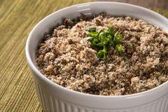 Farofa, a toasted cassava flour mixture. Farofa, a toasted cassava flour mixture Royalty Free Stock Images