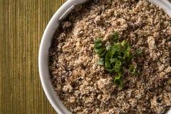 Farofa, a toasted cassava flour mixture. Farofa, a toasted cassava flour mixture Stock Images
