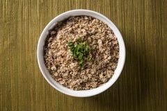 Farofa, a toasted cassava flour mixture. Farofa, a toasted cassava flour mixture Royalty Free Stock Photo