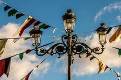 Farol adornado con las banderas para un partido Imágenes de archivo libres de regalías