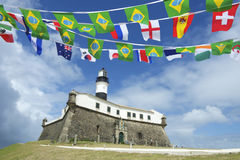 Farol da Barra Salvador Brazil Lighthouse International Flags Arkivbilder