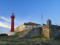 The Farol de Esposende Esposende Lighthouse set in front of the Fort of Sao Joao Baptista de Esposende. Is situated at the mouth of Cavado river, north of stock images